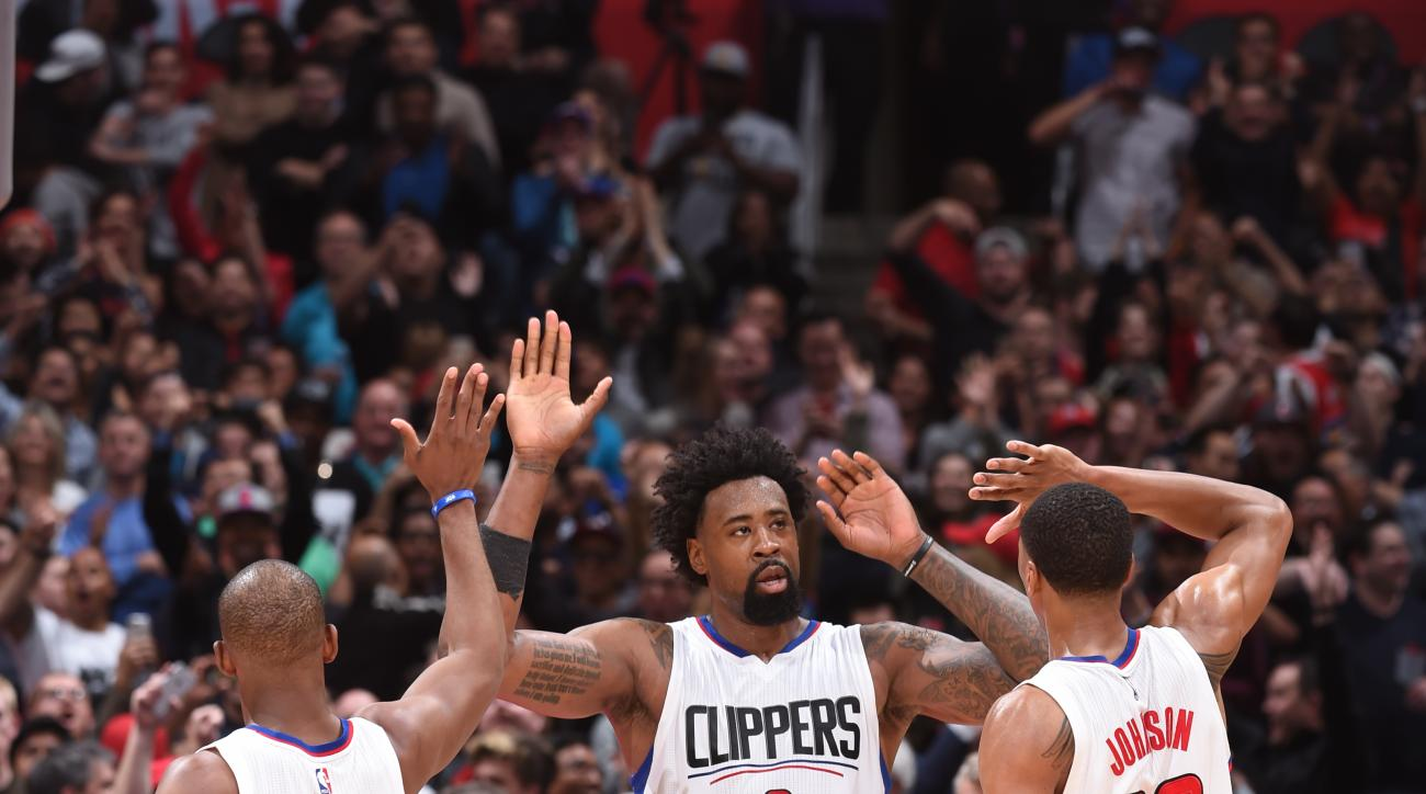 LOS ANGELES, CA  - MARCH 2: DeAndre Jordan #6 high fives teammates Chris Paul #3 and Wesley Johnson #33 of the Los Angeles Clippers during the game against the Oklahoma City Thunder on March 2, 2016 at STAPLES Center in Los Angeles, California. (Photo by