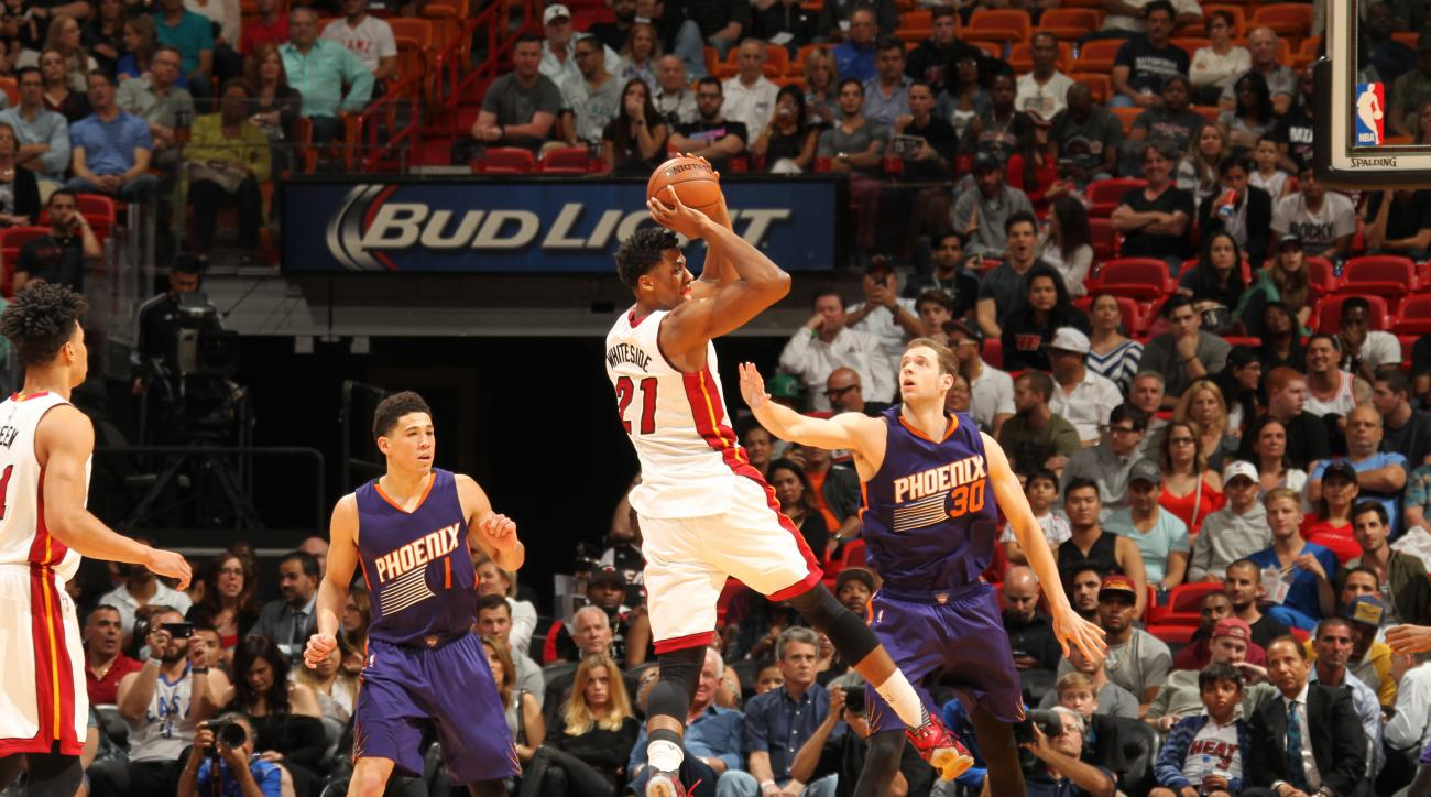 MIAMI, FL  - MARCH 3: Hassan Whiteside #21 of the Miami Heat shoots against the Phoenix Suns during the game on March 3, 2016 at American Airlines Arena in Miami, Florida. (Photo by Issac Baldizon/NBAE via Getty Images)