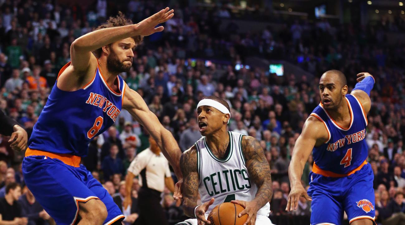 BOSTON, MA - MARCH 04:  Robin Lopez #8 of the New York Knicks and Arron Afflalo #4 defend Isaiah Thomas #4 of the Boston Celtics during the fourth quarter at TD Garden on March 4, 2016 in Boston, Massachusetts. The Celtics defeat the Knicks 105-104. (Phot