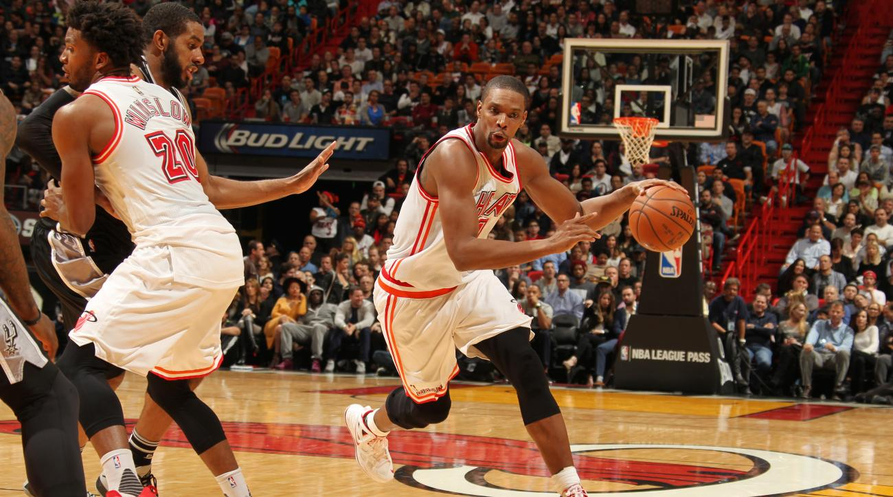MIAMI, FL - FEBRUARY 9:  Chris Bosh #1 of the Miami Heat drives to the basket against the San Antonio Spurs on February 9, 2016 at American Airlines Arena in Miami, Florida. (Photo by Issac Baldizon/NBAE via Getty Images)