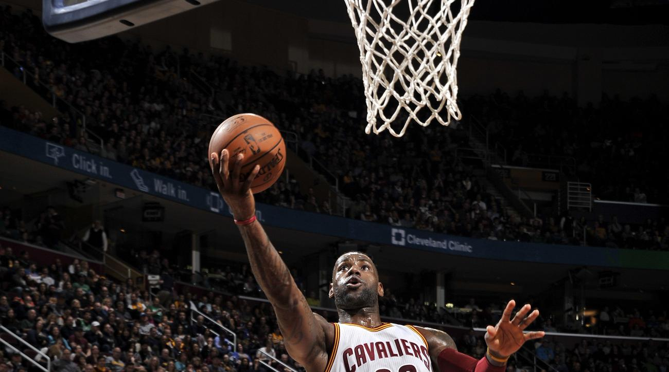 CLEVELAND, OH - MARCH 5: LeBron James #23 of the Cleveland Cavaliers shoots a lay up during the game against the Boston Celtics on March 5, 2016 at Quicken Loans Arena in Cleveland, Ohio.  (Photo by David Liam Kyle/NBAE via Getty Images)