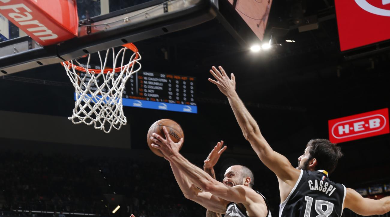 SAN ANTONIO, TX - MARCH 5: Manu Ginobili #20 of the San Antonio Spurs shoots the ball against the Sacramento Kings on March 5, 2016 at the AT&T Center in San Antonio, Texas.