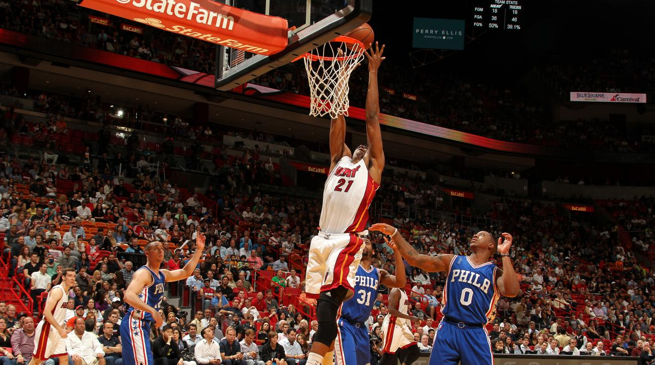 MIAMI, FL - MARCH 6: Hassan Whiteside #21 of the Miami Heat goes for the dunk during the game against the Philadelphia 76ers on March 6, 2016 at AmericanAirlines Arena in Miami, Florida. (Photo by Issac Baldizon/NBAE via Getty Images)
