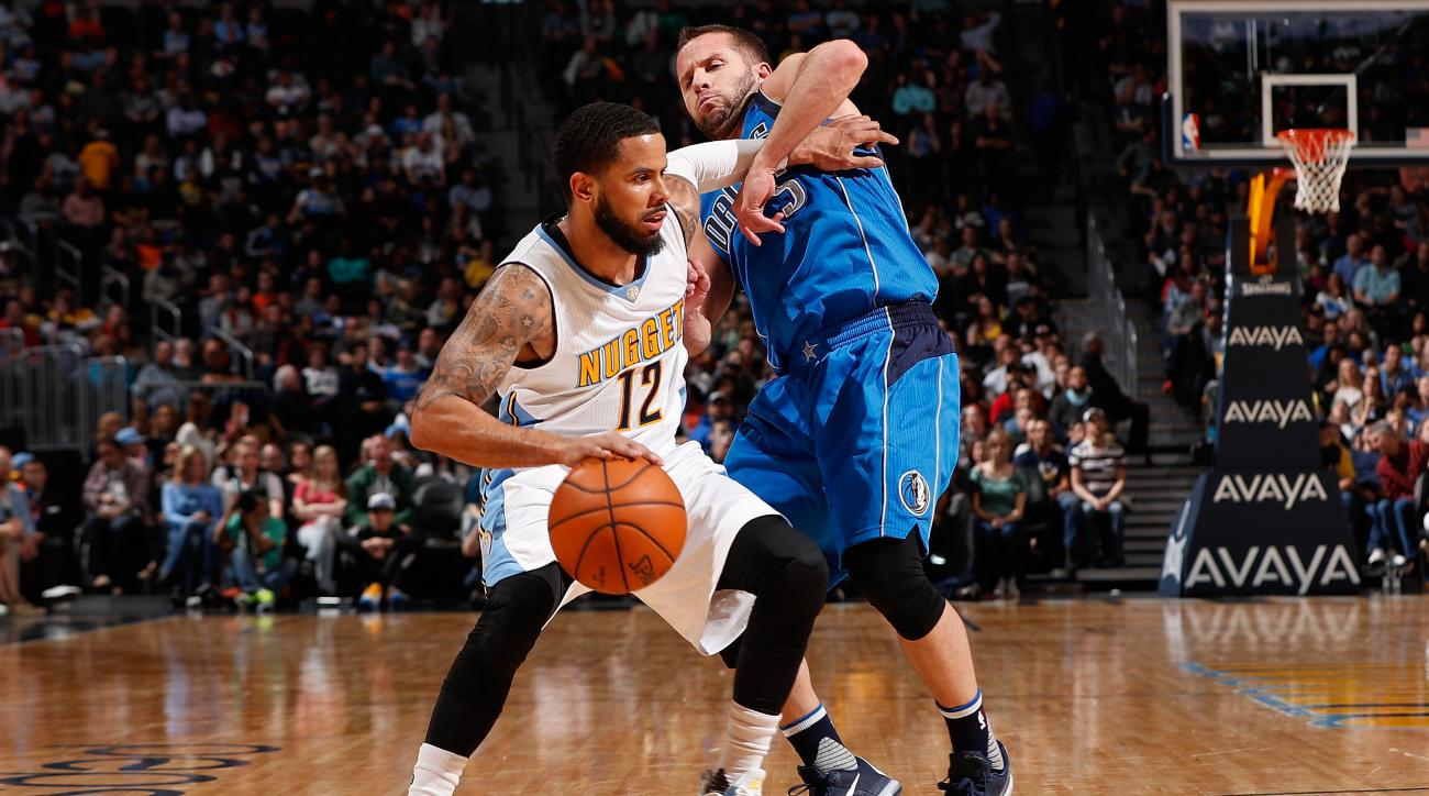 DENVER, CO - MARCH 06:  D.J. Augustin #12 of the Denver Nuggets fends off J.J. Barea #5 of the Dallas Mavericks at Pepsi Center on March 6, 2016 in Denver, Colorado. The Nuggets defeated the Mavericks 116-114 in overtime. (Photo by Doug Pensinger/Getty Im