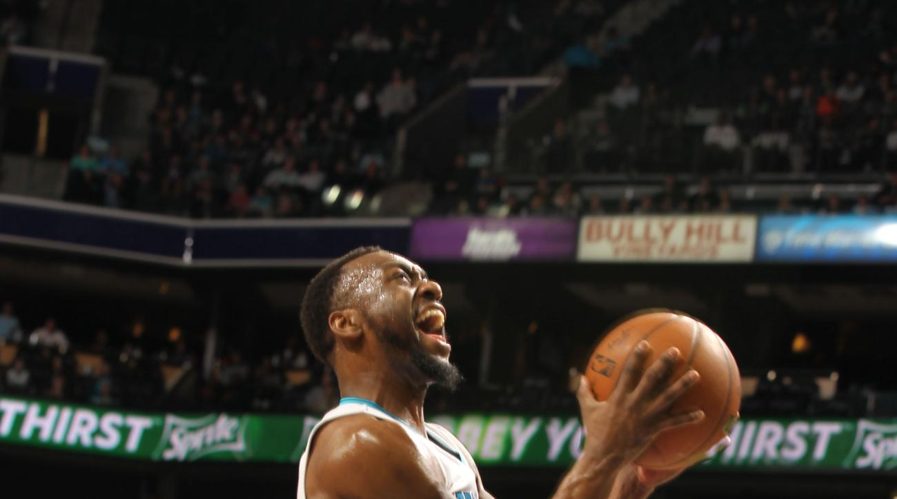 CHARLOTTE, NC - MARCH 07:  Kemba Walker #15 of the Charlotte Hornets shoots against Zach LaVine #8 of the Minnesota Timberwolves during the game at the Time Warner Cable Arena on March 07, 2016 in Charlotte, North Carolina. (Photo by Brock Williams-Smith/