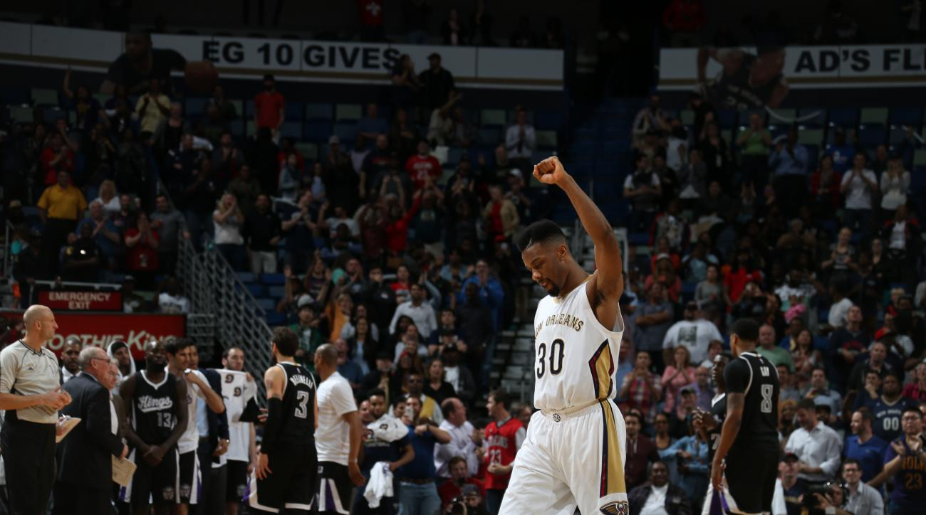 NEW ORLEANS, LA - MARCH 7:  Norris Cole #30 of the New Orleans Pelicans celebrates against the Sacramento Kings on March 7, 2016 at the Smoothie King Center in New Orleans, Louisiana. (Photo by Layne Murdoch Jr./NBAE via Getty Images)