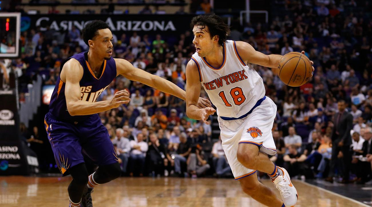 PHOENIX, AZ - MARCH 09:  Sasha Vujacic #18 of the New York Knicks drives the ball past John Jenkins #23 of the Phoenix Suns during the first half of the NBA game at Talking Stick Resort Arena on March 9, 2016 in Phoenix, Arizona.  (Photo by Christian Pete