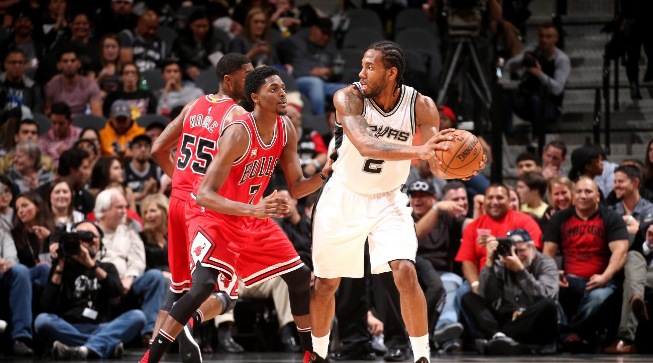 SAN ANTONIO, TX - MARCH 10: Kawhi Leonard #2 of the San Antonio Spurs handles the ball during the game against the Chicago Bulls on March 10, 2016 at the AT&T Center in San Antonio, Texas.