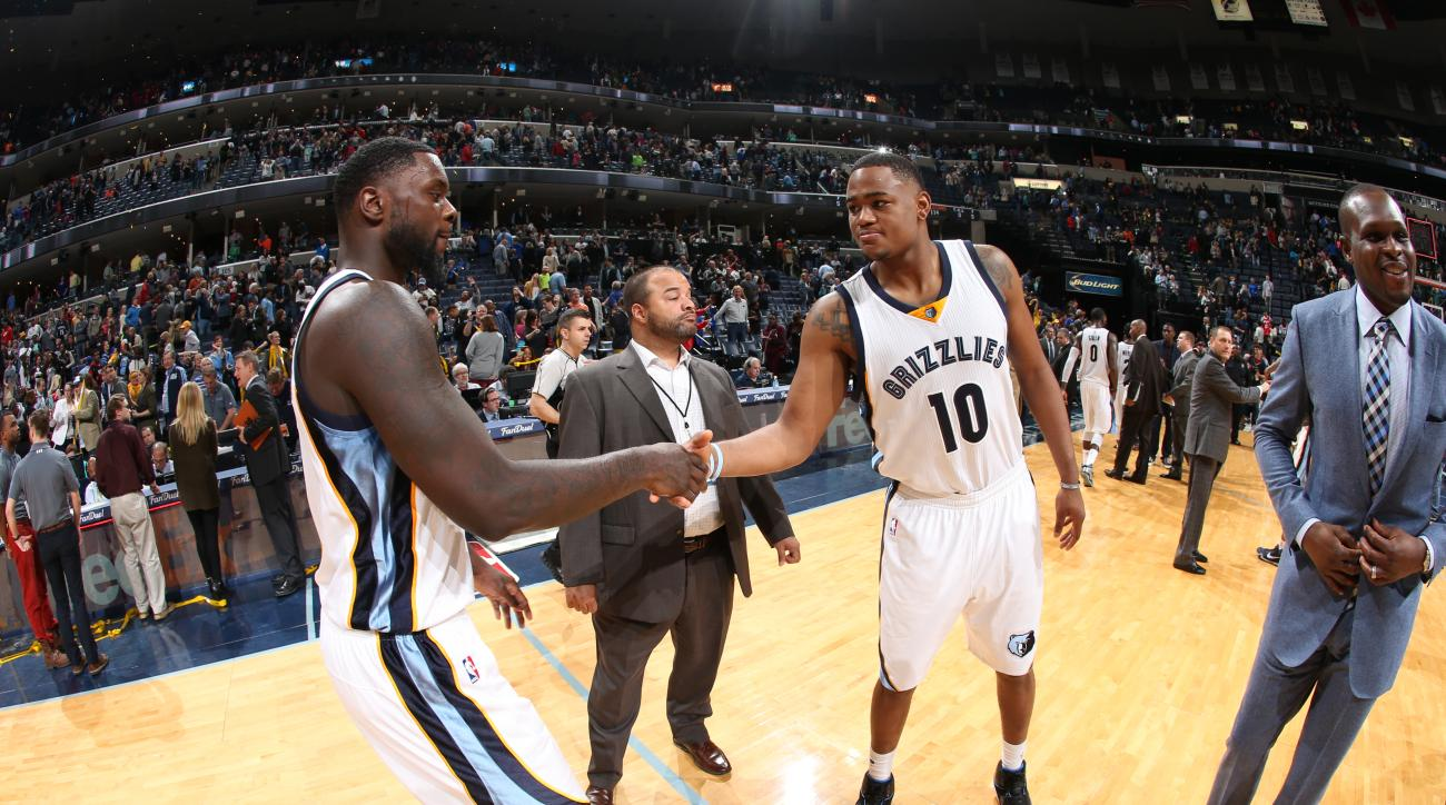 MEMPHIS, TN  - MARCH 11: Lance Stephenson #1 shakes teammates hand Jarell Martin #10 of the Memphis Grizzlies during the game on March 9, 2016 at FedExForum in Memphis, Tennessesse. (Photo by Joe Murphy/NBAE via Getty Images)