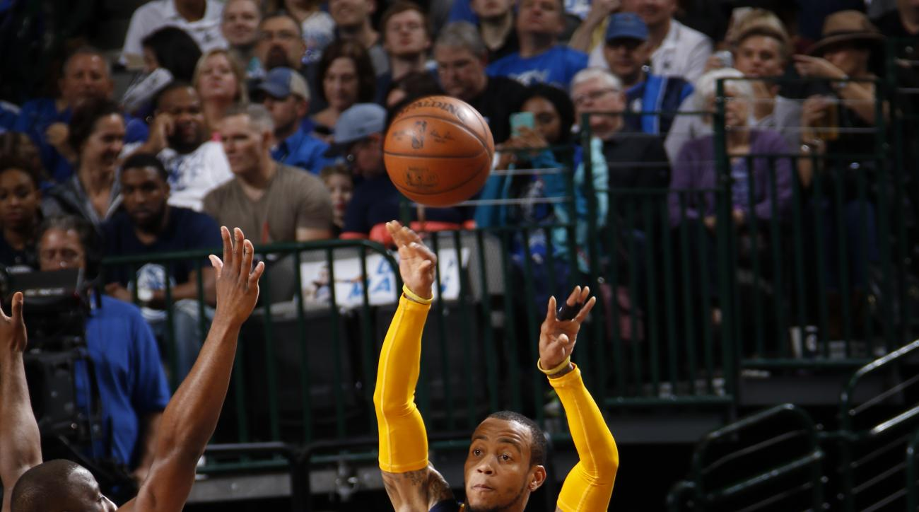 DALLAS, TX - MARCH 12: Monta Ellis #11 of the Indiana Pacers makes a pass to a teammate against the Dallas Mavericks on March 12, 2016 at the American Airlines Center in Dallas, Texas. (Photo by Glenn James/NBAE via Getty Images)