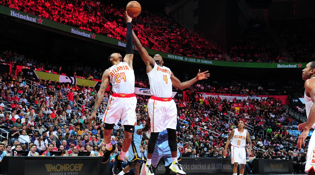 ATLANTA, GA  - MARCH 12: Kent Bazemore #24 goes for the rebound with Paul Millsap #4 of the Atlanta Hawks during the game against the Memphis Grizzlies on March 12, 2016 at Philips Arena in Atlanta, Georgia. (Photo by Scott Cunningham/NBAE via Getty Image