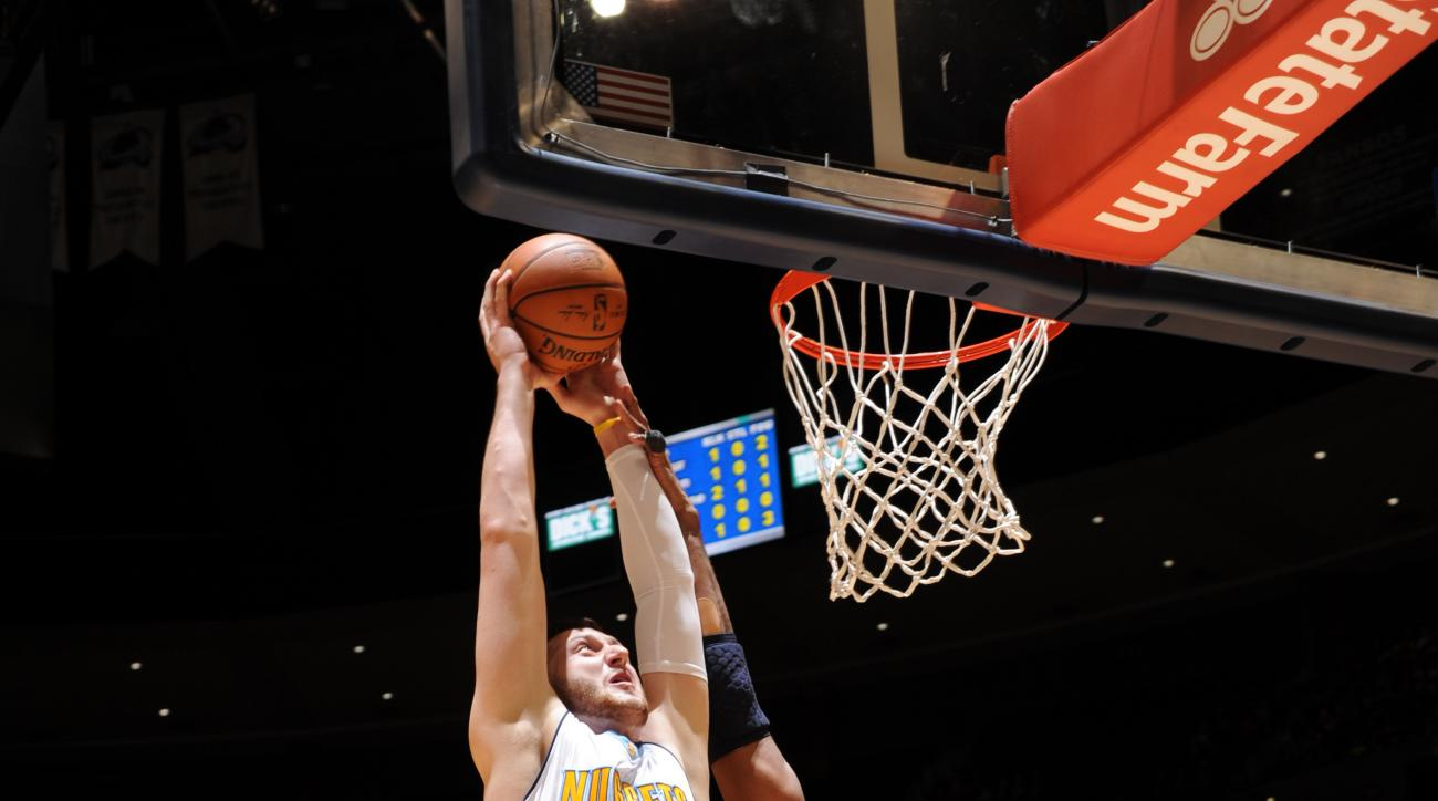 DENVER, CO - MARCH 12:  Jusuf Nurkic #23 of the Denver Nuggets goes to the basket against the Washington Wizards on March 12, 2016 at the Pepsi Center in Denver, Colorado. (Photo by Garrett Ellwood/NBAE via Getty Images)