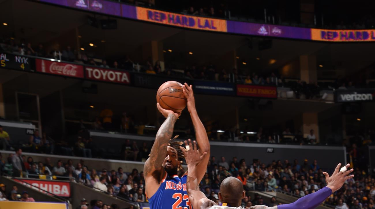 LOS ANGELES, CA - MARCH 13:  Derrick Williams #23 of the New York Knicks shoots against Kobe Bryant #24 of the Los Angeles Lakers on March 13, 2016 at STAPLES Center in Los Angeles, California. (Photo by Andrew D. Bernstein/NBAE via Getty Images)
