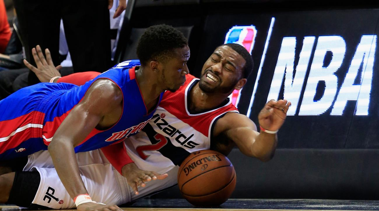 WASHINGTON, DC - MARCH 14: Reggie Jackson #1 of the Detroit Pistons and John Wall #2 of the Washington Wizards go after a loose ball in the second half at Verizon Center on March 14, 2016 in Washington, DC.  (Photo by Rob Carr/Getty Images)