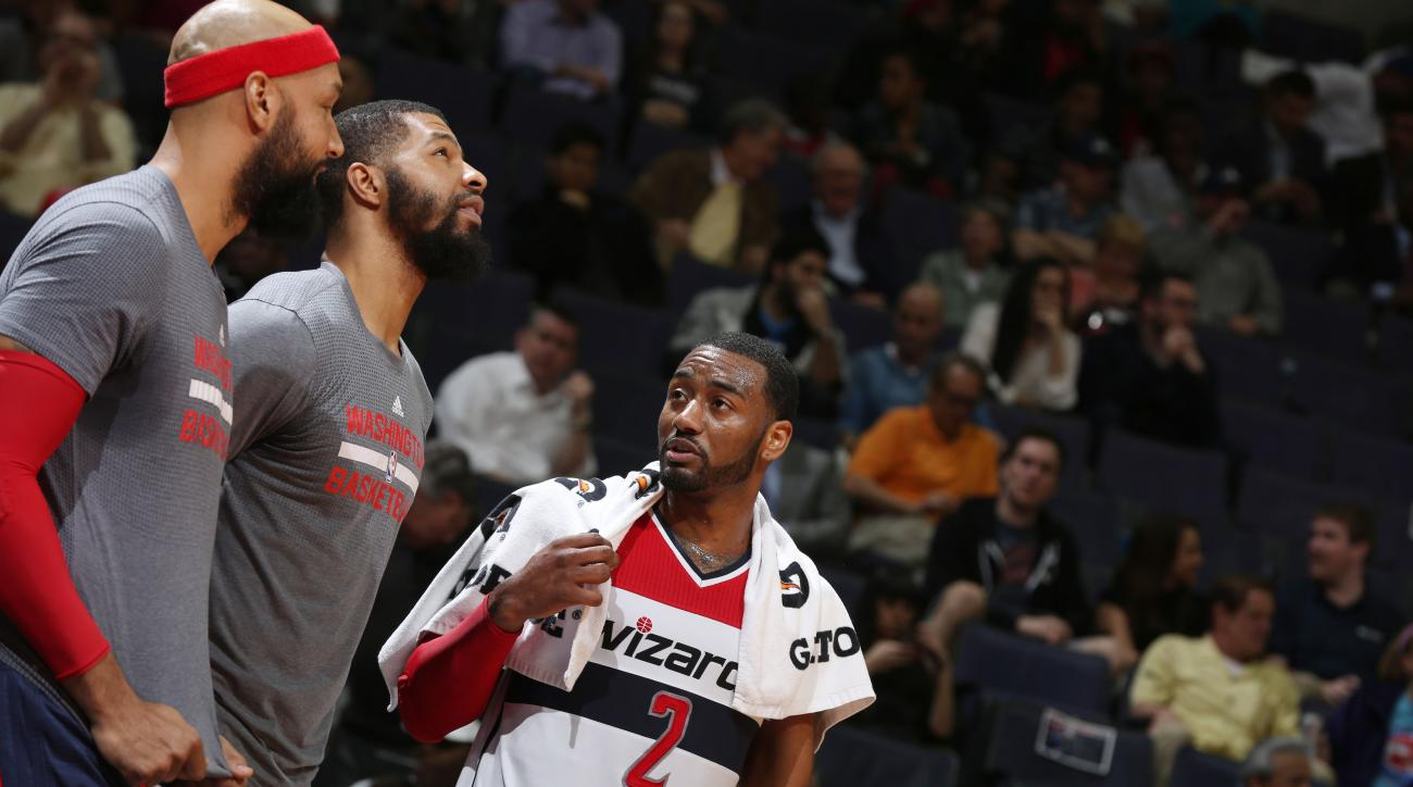 WASHINGTON, DC  - MARCH 16: John Wall #2 of the Washington Wizards and teammates during the game against the Chicago Bulls on March 16, 2016 at Verizon Center in Washington, District of Columbia. (Photo by Stephen Gosling/NBAE via Getty Images)