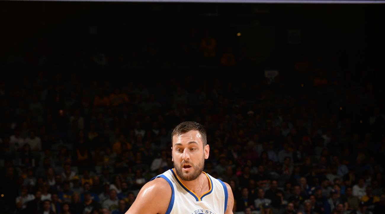 OAKLAND, CA - MARCH 16:  Andrew Bogut #12 of the Golden State Warriors handles the ball against the New York Knicks on March 16, 2016 at ORACLE Arena in Oakland, California. (Photo by Noah Graham/NBAE via Getty Images)