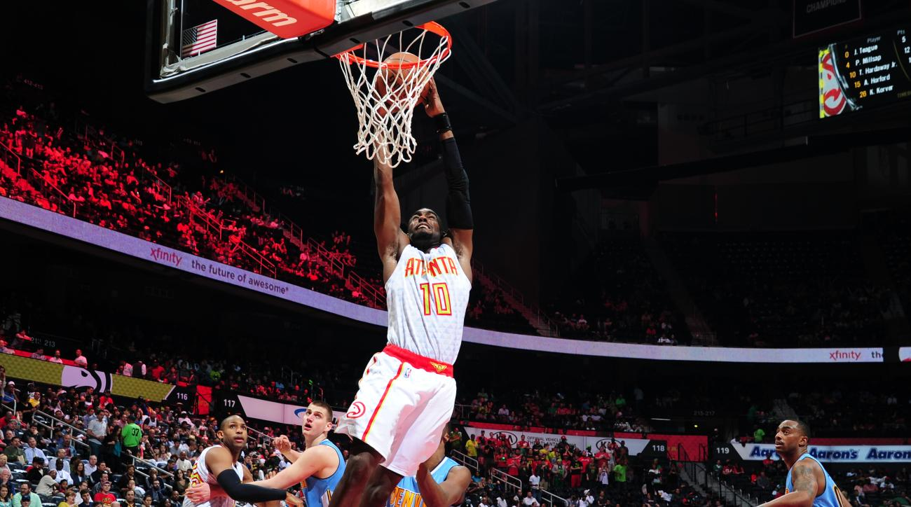 ATLANTA, GA - MARCH 17: Tim Hardaway Jr. #10 of the Atlanta Hawks dunks against the Denver Nuggets on March 17, 2016 at Philips Arena in Atlanta, Georgia.  (Photo by Scott Cunningham/NBAE via Getty Images)