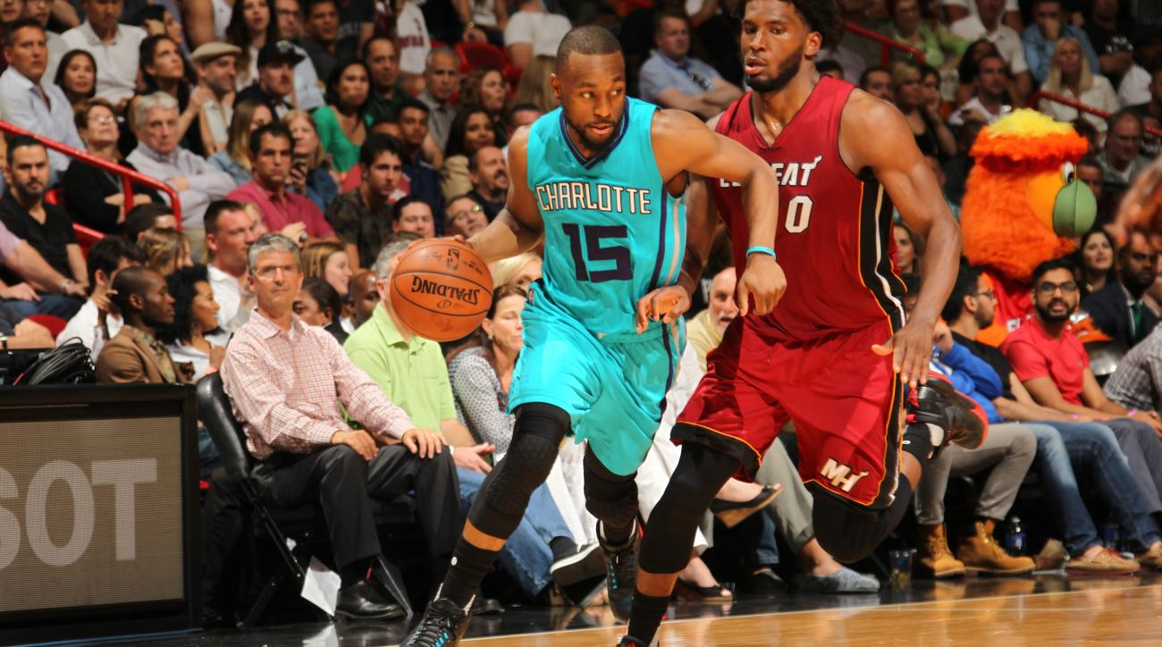 MIAMI, FL - MARCH 17:  Kemba Walker #15 of the Charlotte Hornets dribbles the ball against the Miami Heat on March 17, 2016 at AmericanAirlines Arena in Miami, Florida. (Photo by Oscar Baldizon/NBAE via Getty Images)