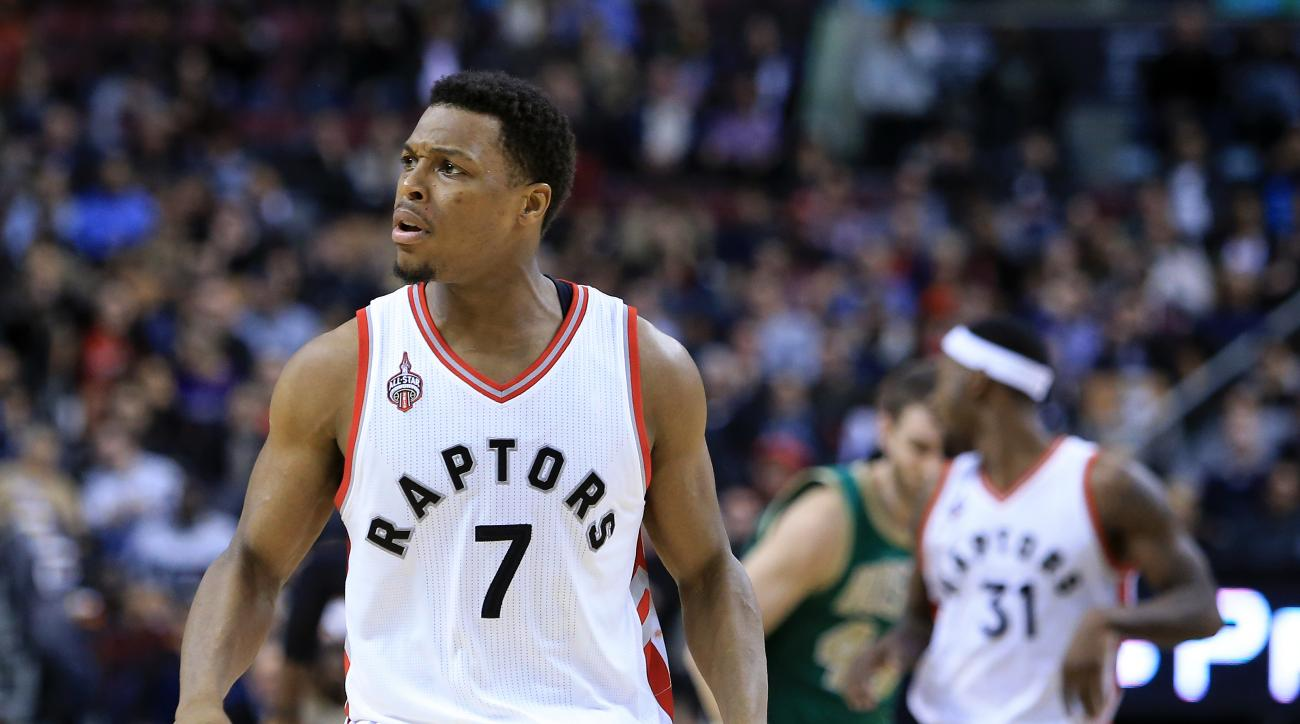 TORONTO, ON - MARCH 18:  Kyle Lowry #7 of the Toronto Raptors gestures to the crowd after sinking a 3-pointer during the second half of an NBA game against the Boston Celtics at the Air Canada Centre on March 18, 2016 in Toronto, Ontario, Canada.  (Photo