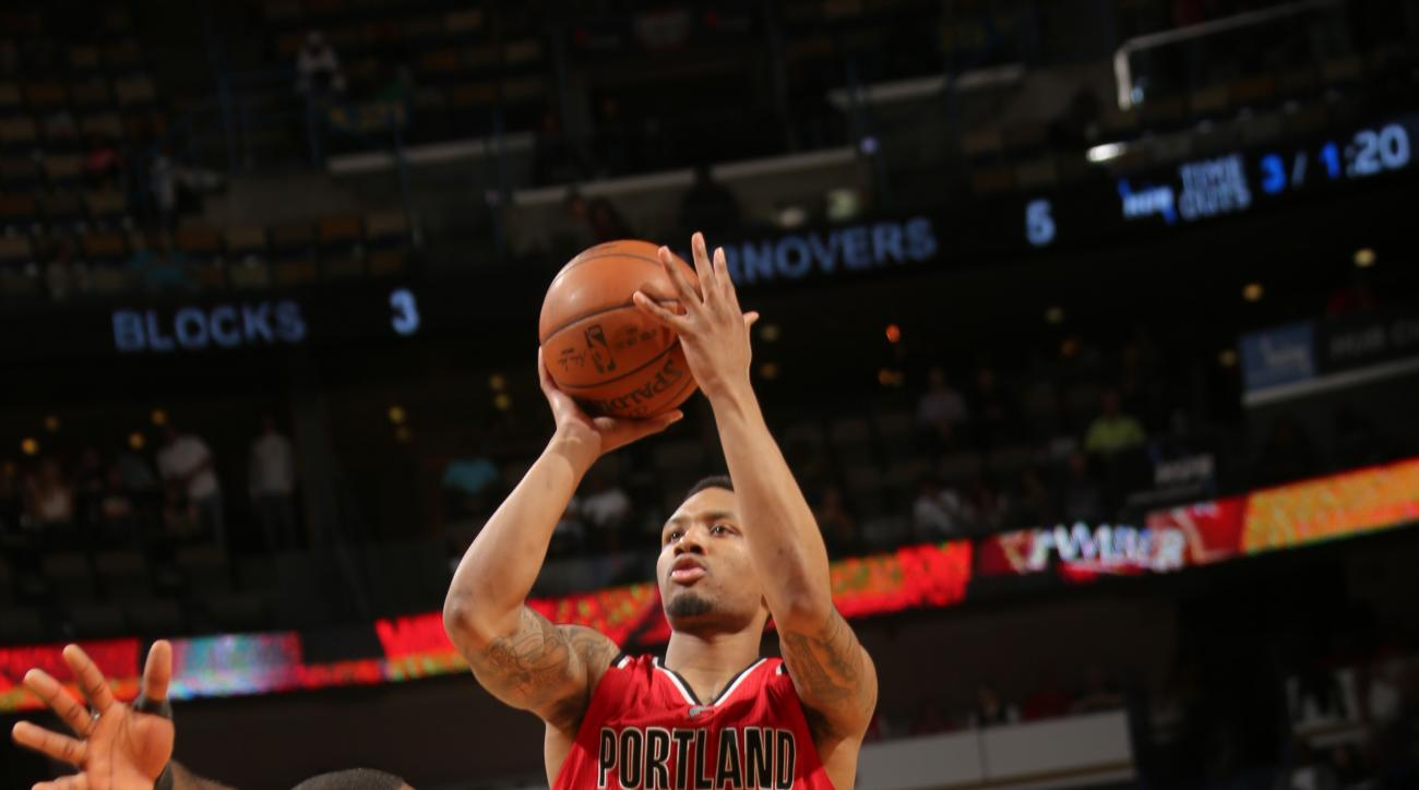 NEW ORLEANS, LA  - MARCH 18: Damian Lillard #0 of the Portland Trail Blazers goes for the lay up against the New Orleans Pelicans during the game on March 18, 2016 at Smoothie King Center in New Orleans, Louisiana. (Photo by Layne Murdoch/NBAE via Getty I