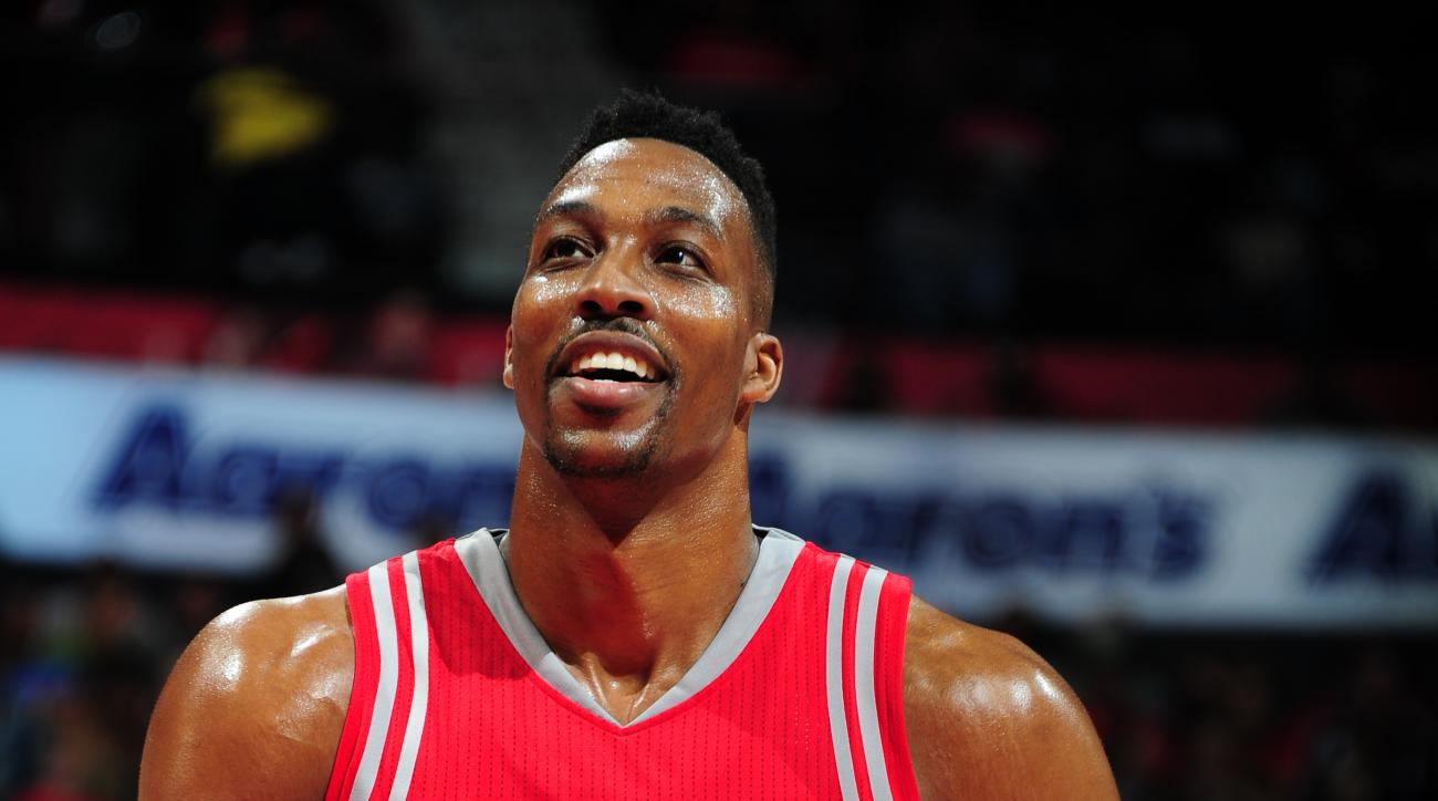 ATLANTA, GA - MARCH 19:  Dwight Howard #12 of the Houston Rockets shoots a free throw against the Atlanta Hawks on March 19, 2016 at Philips Center in Atlanta, Georgia.  (Photo by Scott Cunningham/NBAE via Getty Images)