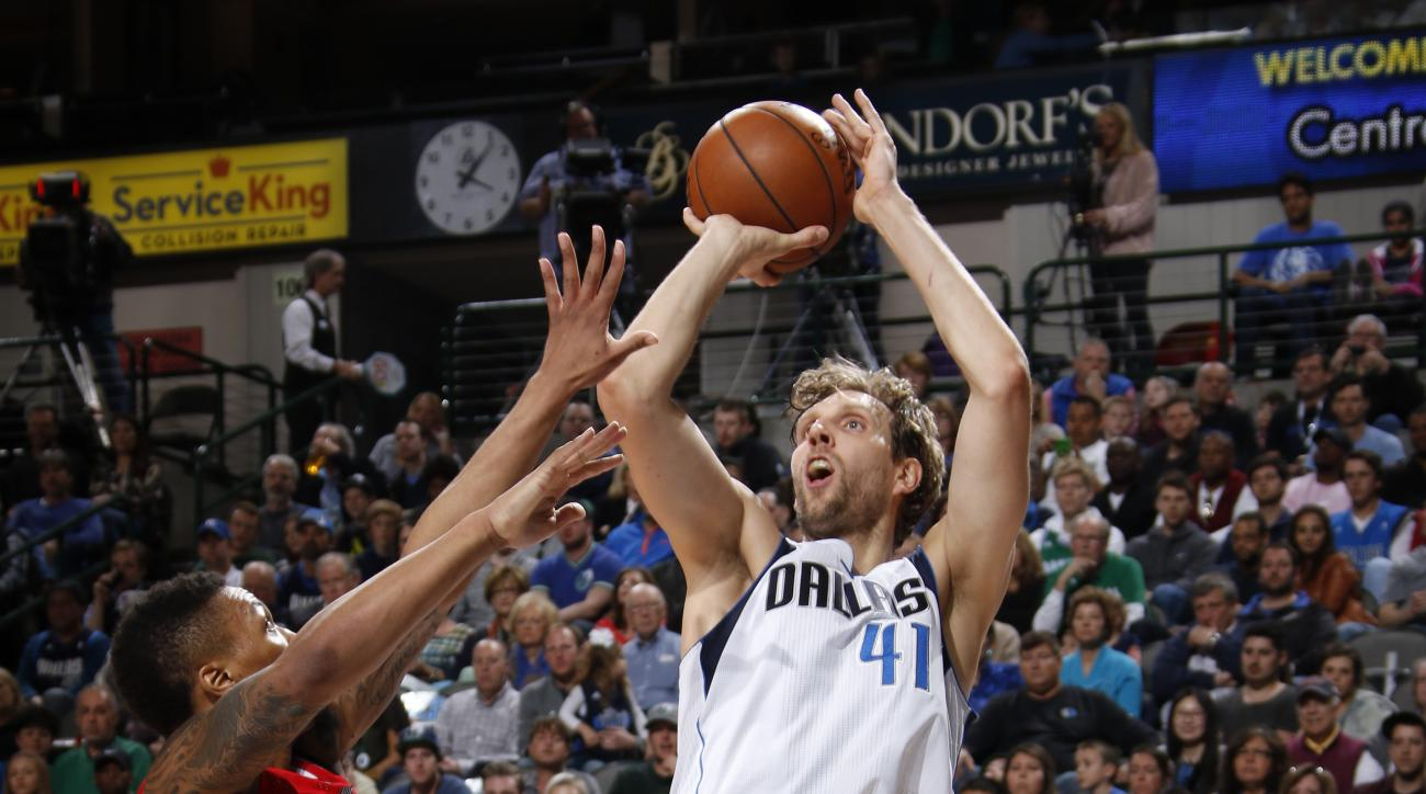 DALLAS, TX - MARCH 20: Dirk Nowitzki #41 of the Dallas Mavericks shoots a jumper against the Portland Trail Blazers on March 20, 2016 at the American Airlines Center in Dallas, Texas. (Photo by Glenn James/NBAE via Getty Images)