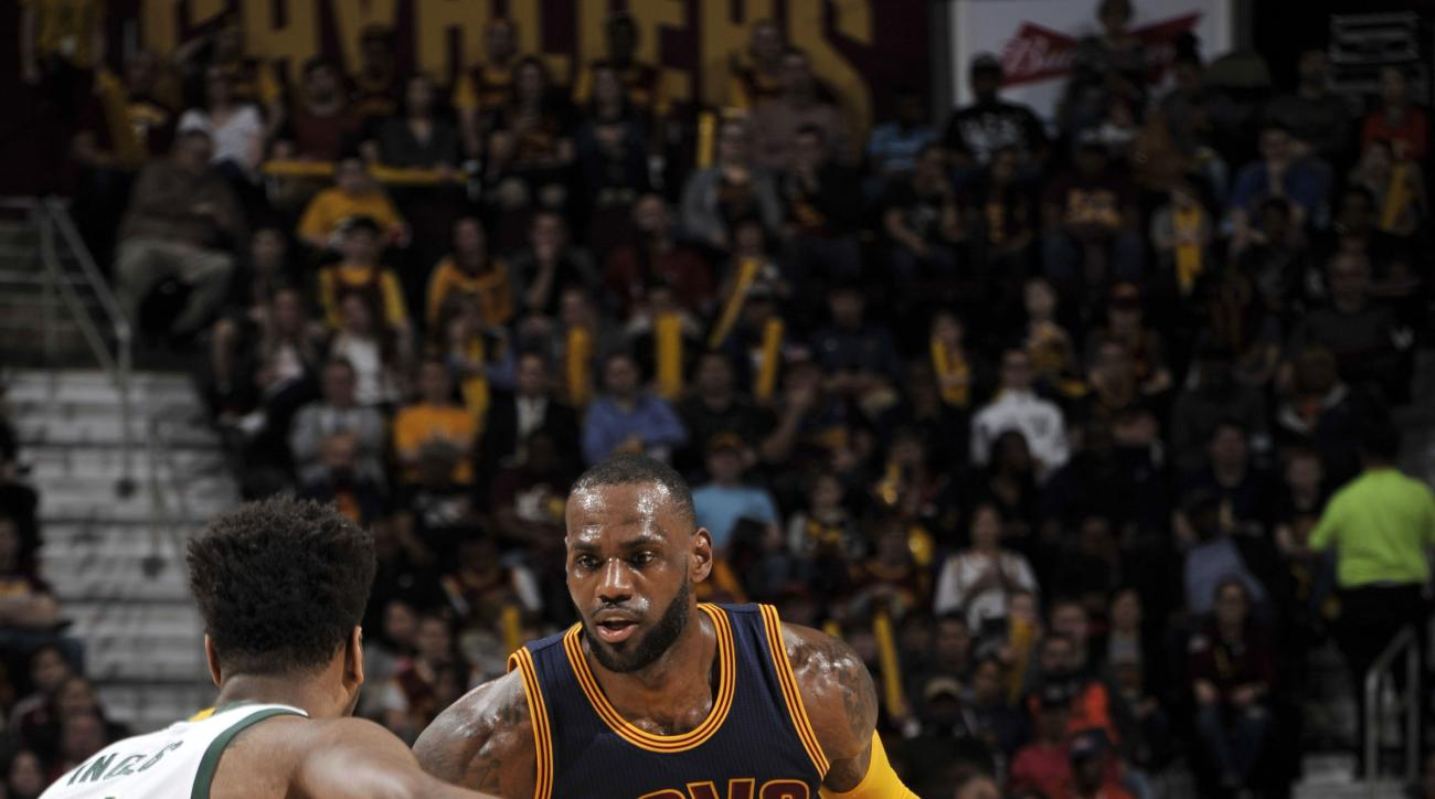 CLEVELAND, OH - MARCH 23:  LeBron James #23 of the Cleveland Cavaliers handles the ball against the Milwaukee Buckson March 23, 2016 at Quicken Loans Arena in Cleveland, Ohio.  (Photo by David Liam Kyle/NBAE via Getty Images)