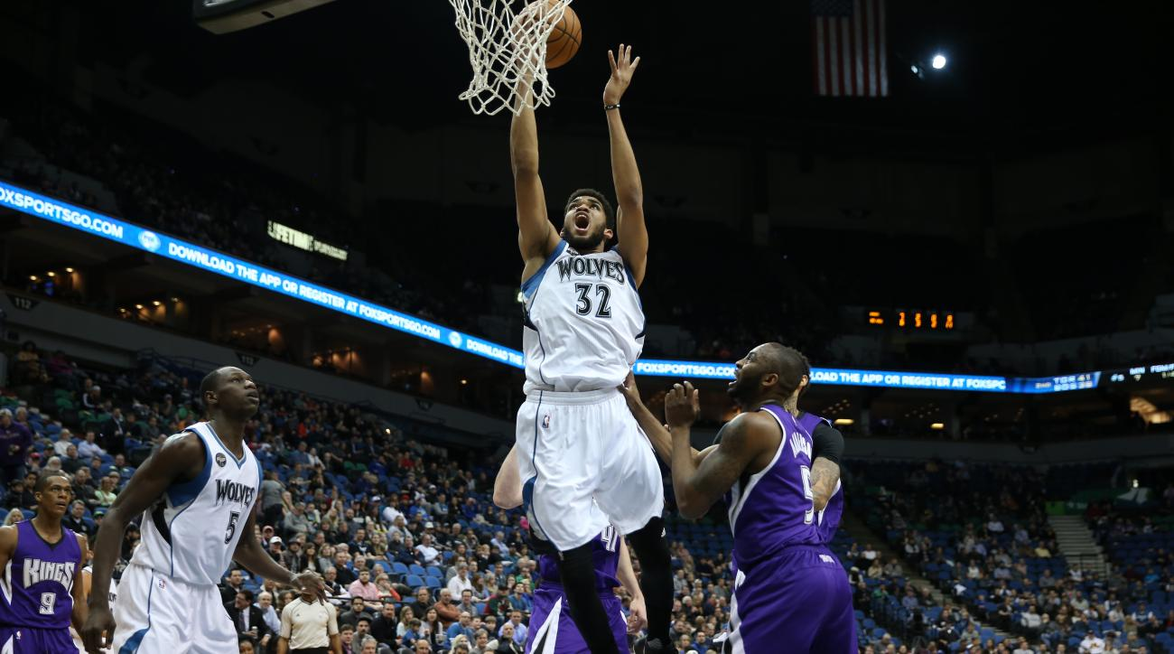MINNEAPOLIS, MN -  MARCH 23: Karl-Anthony Towns #32 of the Minnesota Timberwolves shoots the ball against the Sacramento Kings   on March 23, 2016 at Target Center in Minneapolis, Minnesota. (Photo by Jordan Johnson/NBAE via Getty Images)