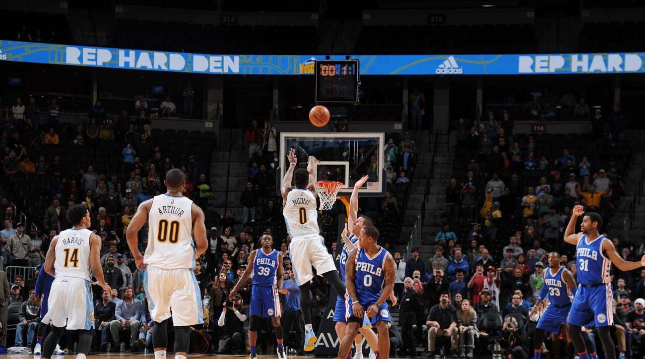DENVER, CO - MARCH 23:  Emmanuel Mudiay #0 of the Denver Nuggets hits the game winning three point shot against the Philadelphia 76ers on March 23, 2016 at the Pepsi Center in Denver, Colorado. (Photo by Bart Young/NBAE via Getty Images)