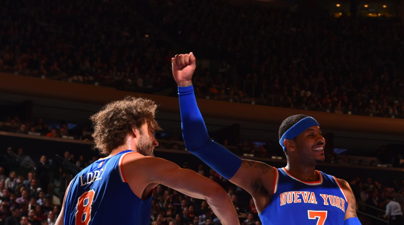 NEW YORK,NY - MARCH 24: Carmelo Anthony #7 of the New York Knicks raises his hand after a play against the Chicago Bulls at Madison Square Garden on March 24, 2016 in New York,New York (Photo by Jesse D. Garrabrant/NBAE via Getty Images)
