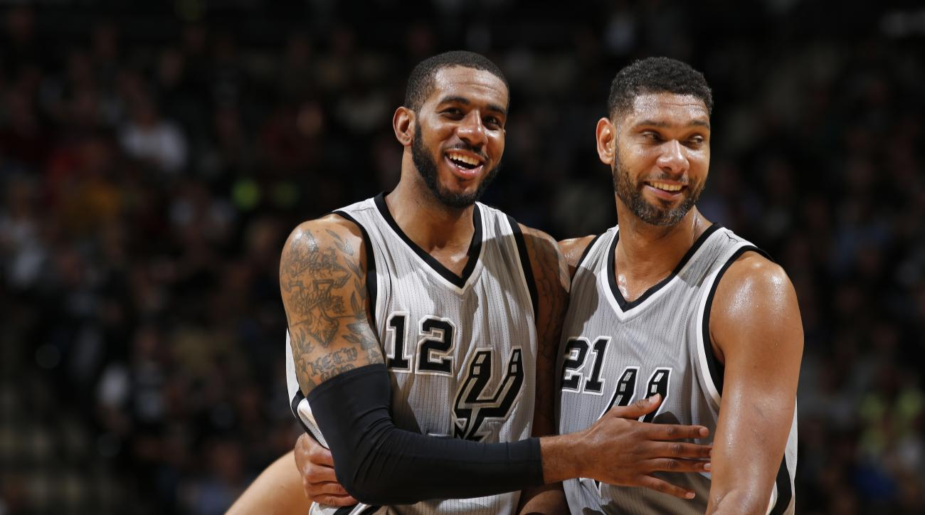 SAN ANTONIO, TX - MARCH 25:  Tim Duncan #21 and LaMarcus Aldridge #12 of the San Antonio Spurs handles the ball against the Memphis Grizzlies on March 25, 2016 at the AT&T Center in San Antonio, Texas.