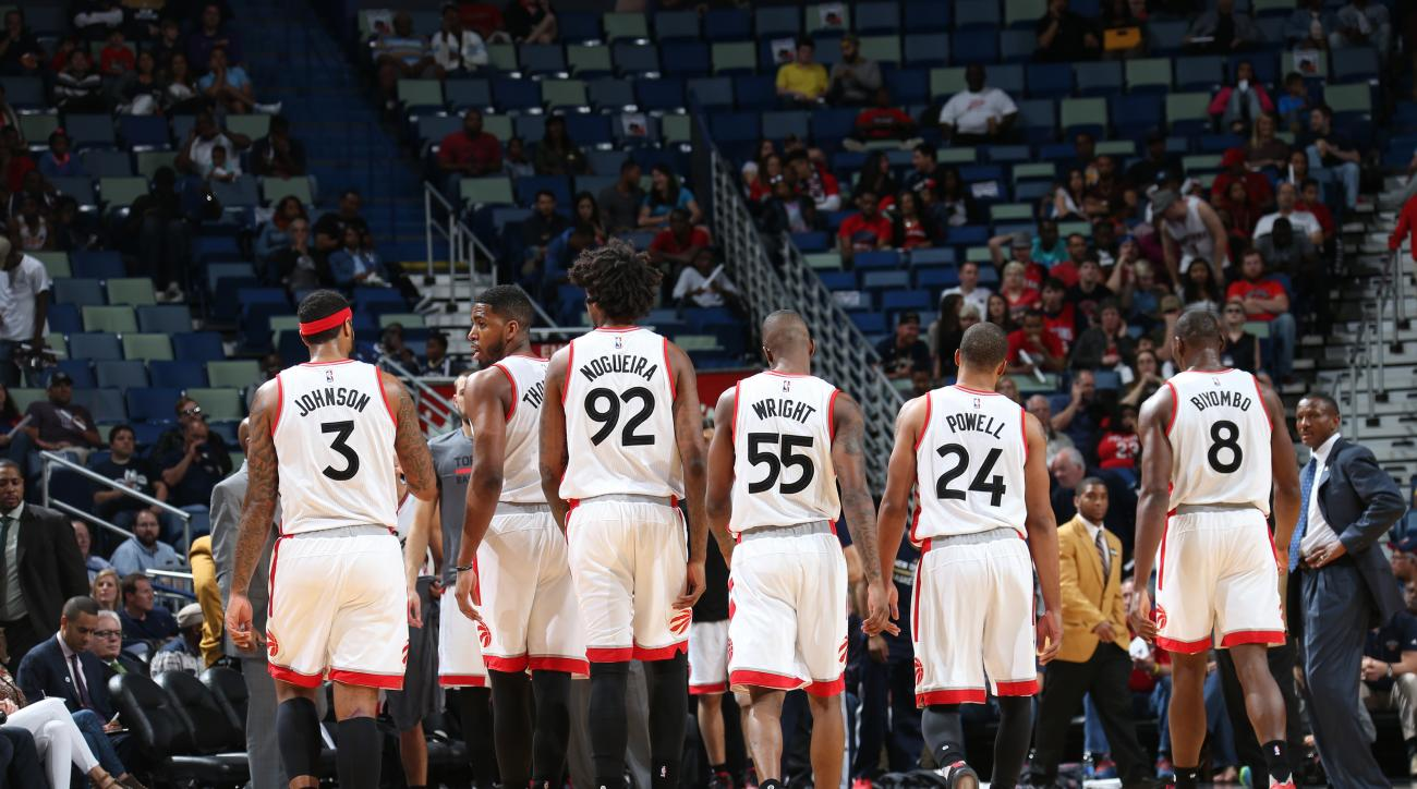 NEW ORLEANS, LA - MARCH 26:  The Toronto Raptors stand on the court during the game against the New Orleans Pelicans on March 26, 2016 at Smoothie King Center in New Orleans, Louisiana. (Photo by Layne Murdoch Jr./NBAE via Getty Images)