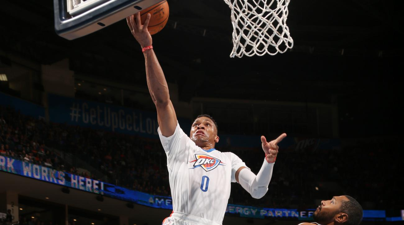 OKLAHOMA CITY, OK  - MARCH 26: Russell Westbrook #0 of the Oklahoma City Thunder goes for the lay up against the San Antonio Spurs during the game on March 26, 2016 at Chesapeake Energy Arena in Oklahoma City, Oklahoma. (Photo by Layne Murdoch/NBAE via Ge