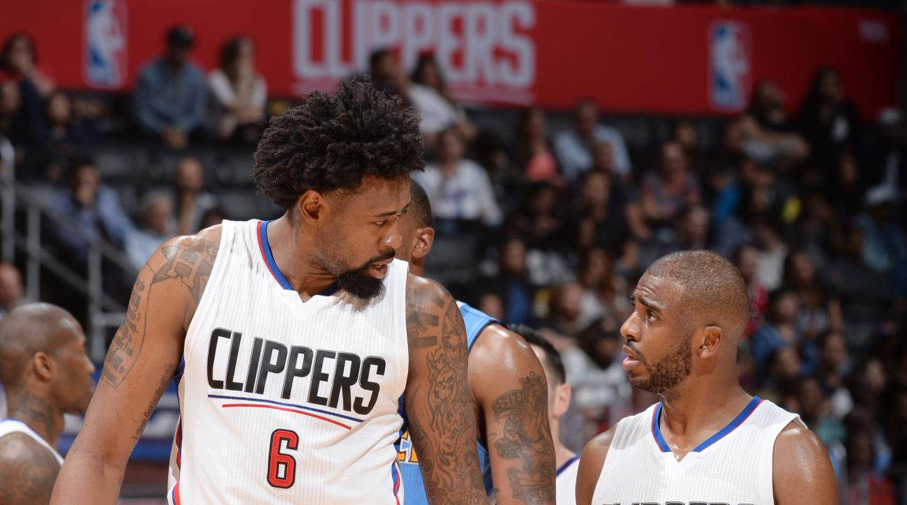 LOS ANGELES, CA - MARCH 27:  DeAndre Jordan #6 of the Los Angeles Clippers and Chris Paul #3 of the Los Angeles Clippers talk during the game against the Denver Nuggets on March 27, 2016 at STAPLES Center in Los Angeles, California. (Photo by Andrew D. Be