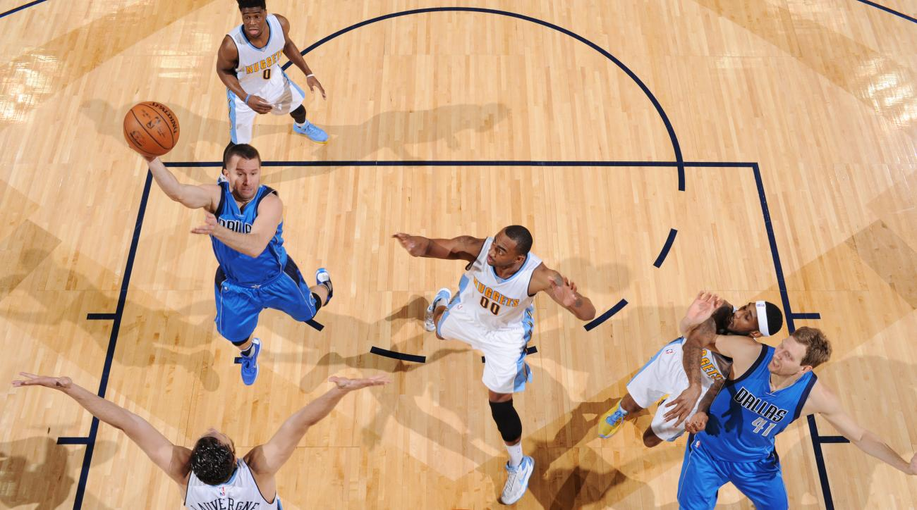 DENVER, CO - MARCH 28:  J.J. Barea #5 of the Dallas Mavericks shoots the ball against the Denver Nuggets on March 28, 2016 at the Pepsi Center in Denver, Colorado. (Photo by Garrett Ellwood/NBAE via Getty Images)