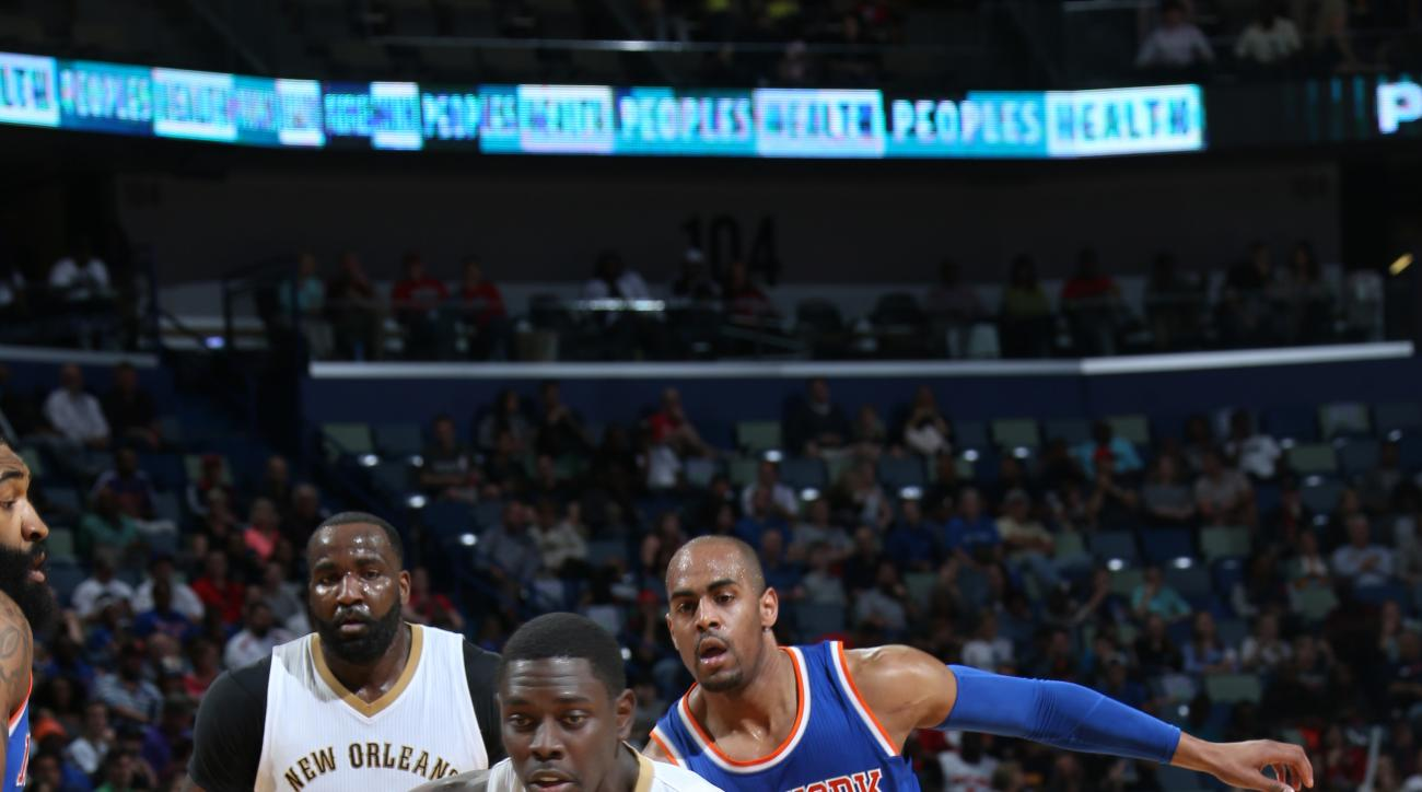 NEW ORLEANS, LA  - MARCH 28: Jrue Holiday #11 of the New Orleans Pelicans drives to the basket against the New York Knicks during the game on March 28, 2016 at Smoothie King Center in New Orleans, Louisiana. (Photo by Layne Murdoch Jr./NBAE via Getty Imag