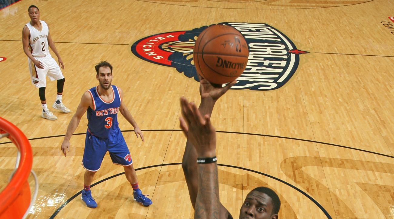 NEW ORLEANS, LA  - MARCH 28: Jrue Holiday #11 of the New Orleans Pelicans shoots against the New York Knicks during the game on March 28, 2016 at Smoothie King Center in New Orleans, Louisiana. (Photo by Layne Murdoch/NBAE via Getty Images)