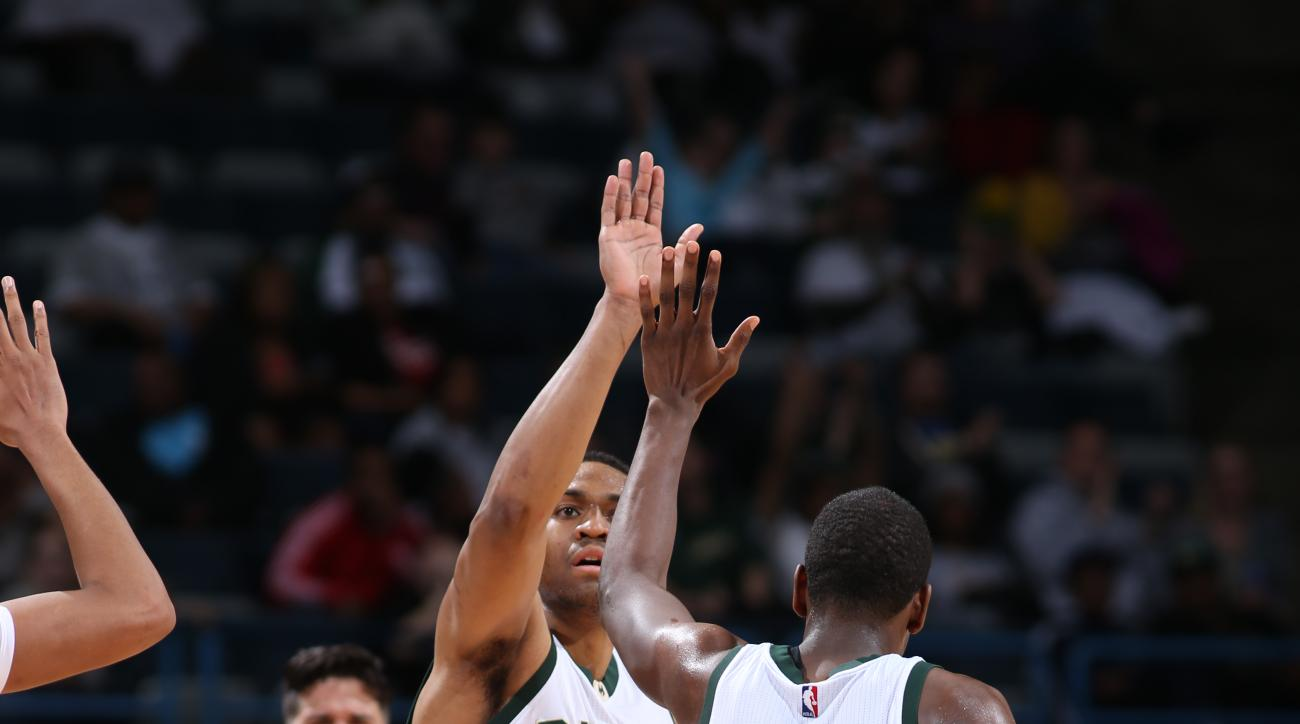 Milwaukee, WI - MARCH 30: Jabari Parker #12 and Khris Middleton #22 of the Milwaukee Bucks celebrate against the Phoenix Suns on March 30, 2016 at the BMO Harris Bradley Center in Milwaukee, Wisconsin. (Photo by Gary Dineen/NBAE via Getty Images)