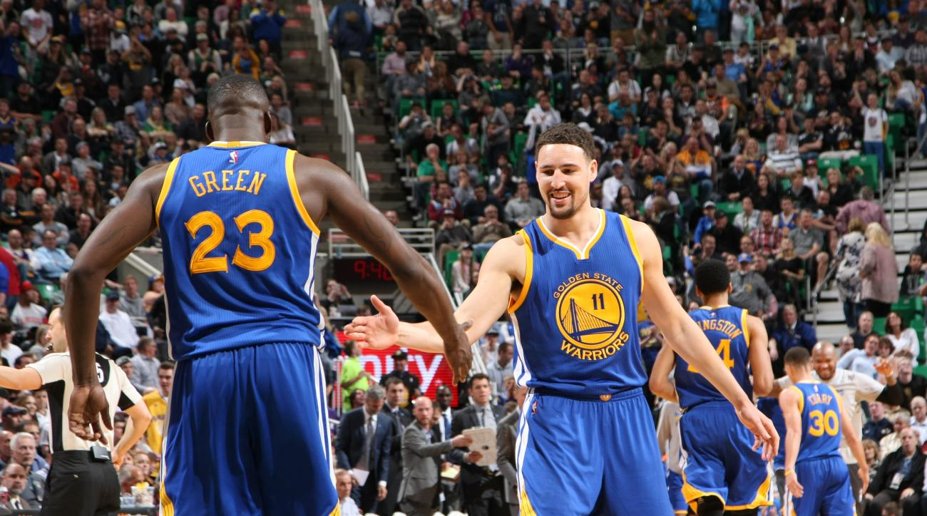 SALT LAKE CITY, UT - MARCH 30:  Draymond Green #23 of the Golden State Warriors celebrates with Klay Thompson #11 of the Golden State Warriors during the game against the Utah Jazz on March 30, 2016 at vivint.SmartHome Arena in Salt Lake City, Utah. (Phot