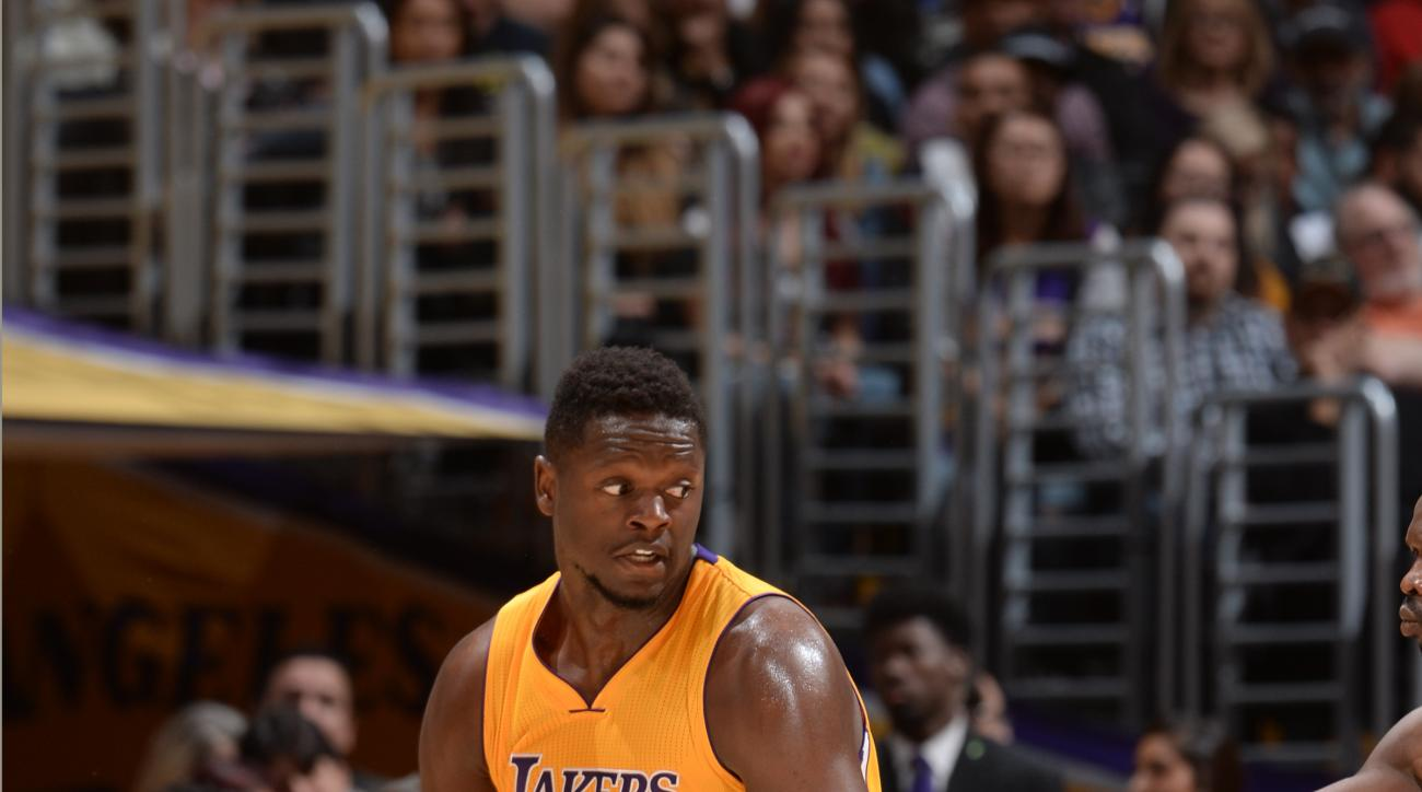 LOS ANGELES, CA - MARCH 30:  Julius Randle #30 of the Los Angeles Lakers handles the ball against the Miami Heat on March 30, 2016 at STAPLES Center in Los Angeles, California. (Photo by Andrew D. Bernstein/NBAE via Getty Images)