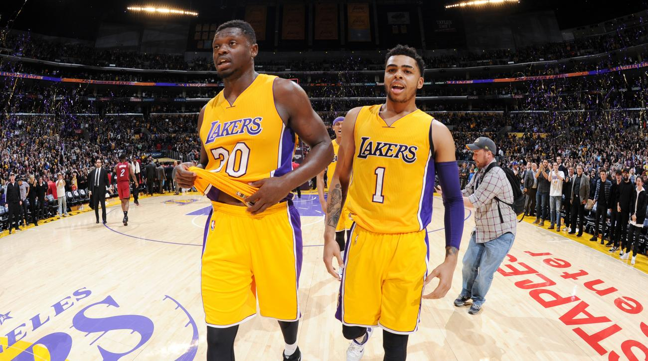 LOS ANGELES, CA - MARCH 30: Julius Randle #30 and D'Angelo Russell #1 of the Los Angeles Lakers celebrate an overtime win against the Miami Heat at STAPLES Center on March 30, 2016 in Los Angeles, California. (Photo by Andrew D. Bernstein/NBAE via Getty I