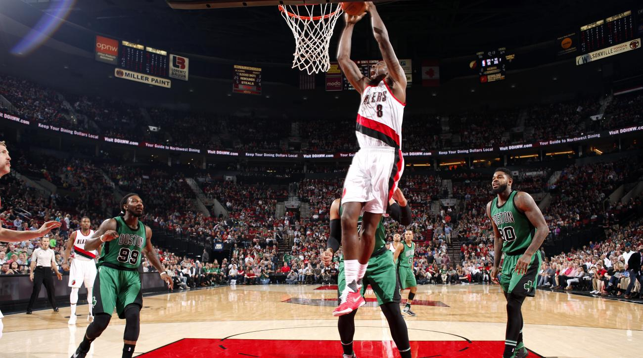 PORTLAND, OR - MARCH 31: Al-Farouq Aminu #8 of the Portland Trail Blazers goes for the dunk during the game against the Boston Celtics on March 31, 2016 at the Moda Center in Portland, Oregon. (Photo by Cameron Browne/NBAE via Getty Images)