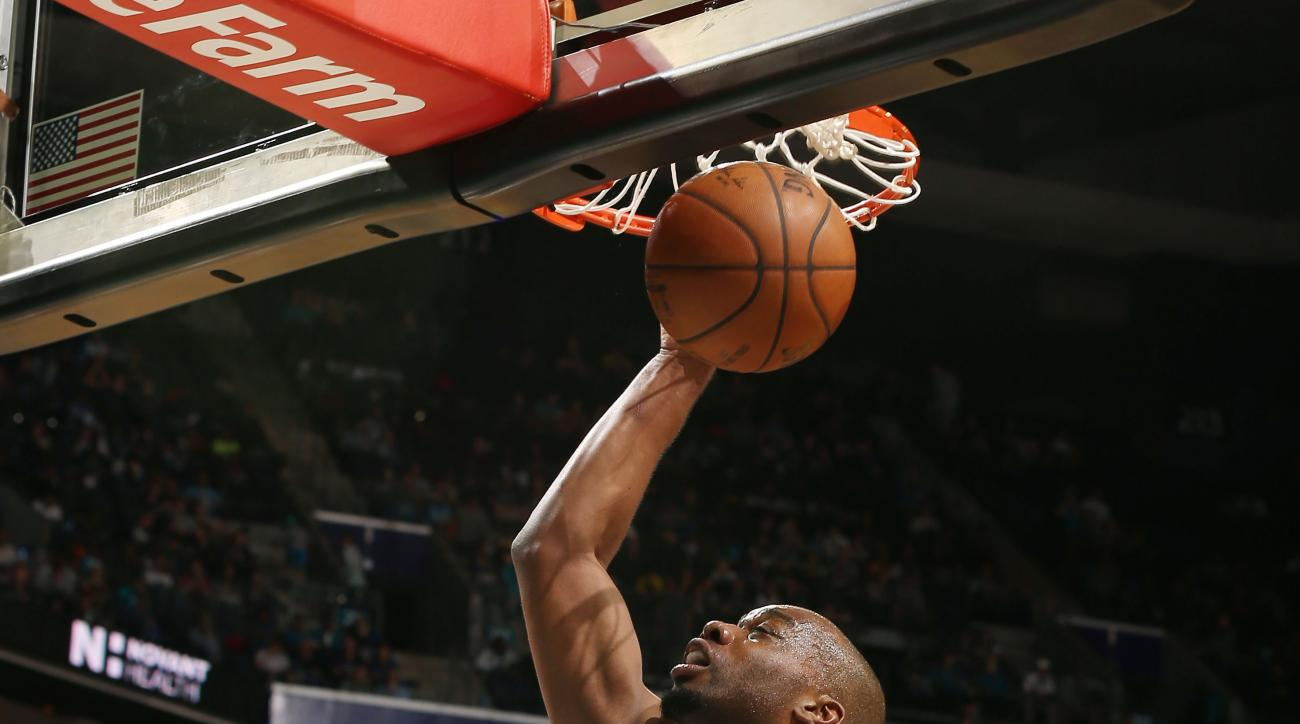 CHARLOTTE, NC  - APRIL 1: Carl Landry #7 of the Philadelphia 76ers goes for the lay up against the Charlotte Hornets during the game on April 1, 2016 at Time Warner Cable Arena in Charlotte, North Carolina. (Photo by Kent Smith/NBAE via Getty Images)