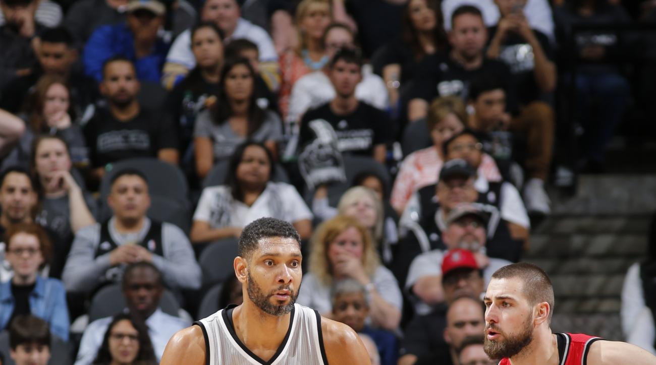 SAN ANTONIO, TX  - APRIL 2: Tim Duncan #21 of the San Antonio Spurs drives to the basket against the Toronto Raptors during the game on April 2, 2016 at AT&T Center in San Antonio, Texas. (Photo by Chris Covatta/NBAE via Getty Images)