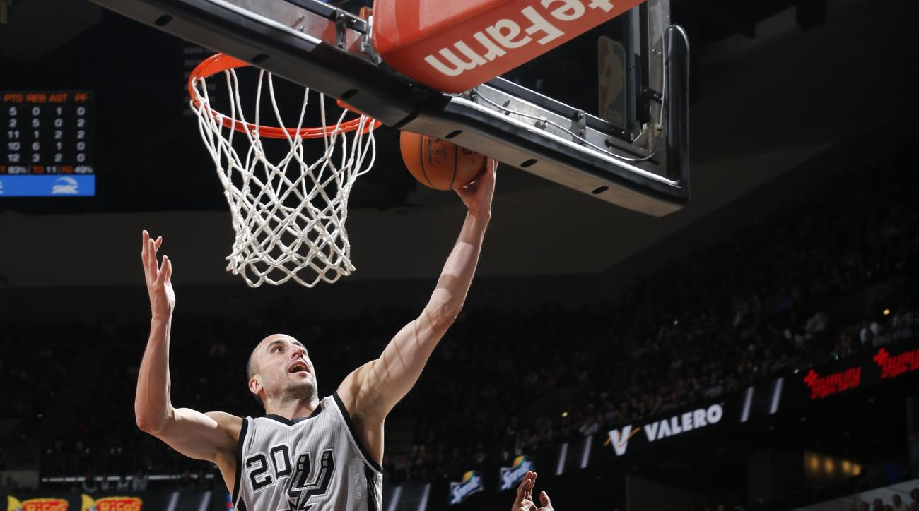SAN ANTONIO, TX  - APRIL 2: Manu Ginobili #20 of the San Antonio Spurs goes for the lay up against the Toronto Raptors during the game on April 2, 2016 at AT&T Center in San Antonio, Texas. (Photo by Chris Covatta/NBAE via Getty Images)