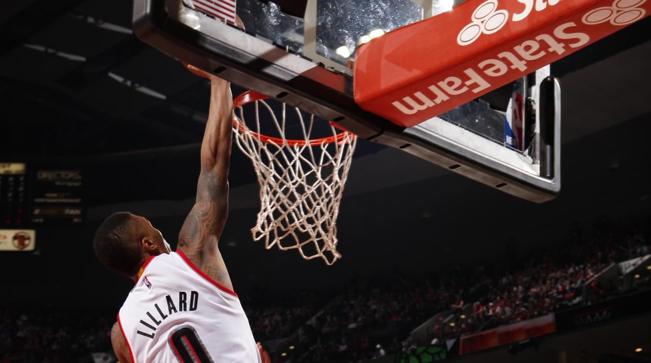 PORTLAND, OR  - APRIL 2: Damian Lillard #0 of the Portland Trail Blazers dunks against the Miami Heat during the game on April 2, 2016 at Moda Center in Portland, Oregon. (Photo by Cameron Browne/NBAE via Getty Images)