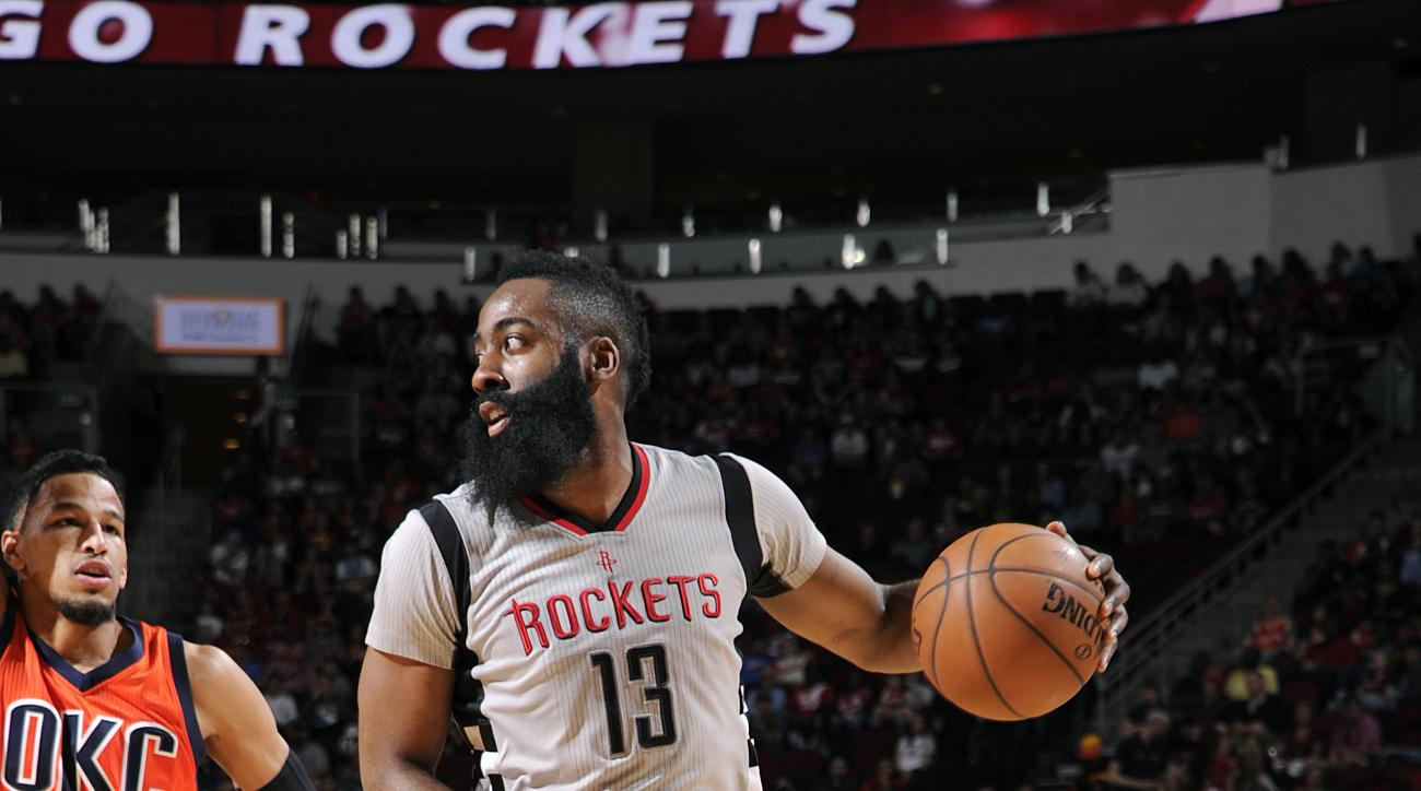 HOUSTON, TX - APRIL 3: James Harden #13 of the Houston Rockets handles the ball during the game against the Oklahoma City Thunder on April 3, 2016 at the Toyota Center in Houston, Texas. (Photo by Bill Baptist/NBAE via Getty Images)