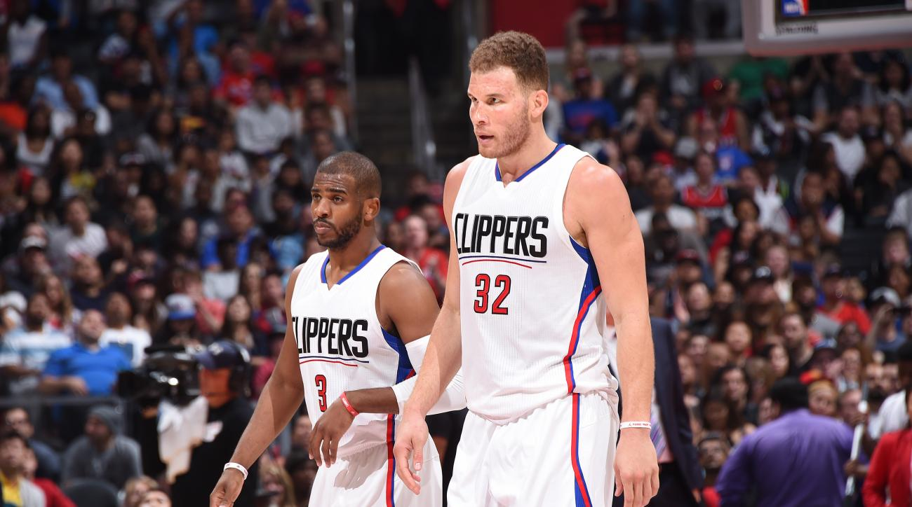 LOS ANGELES, CA - APRIL 3:  Blake Griffin #32 of the Los Angeles Clippers talks with Chris Paul #3 of the Los Angeles Clippers during the game against the Washington Wizards on April 3, 2016 at STAPLES Center in Los Angeles, California. (Photo by Andrew D
