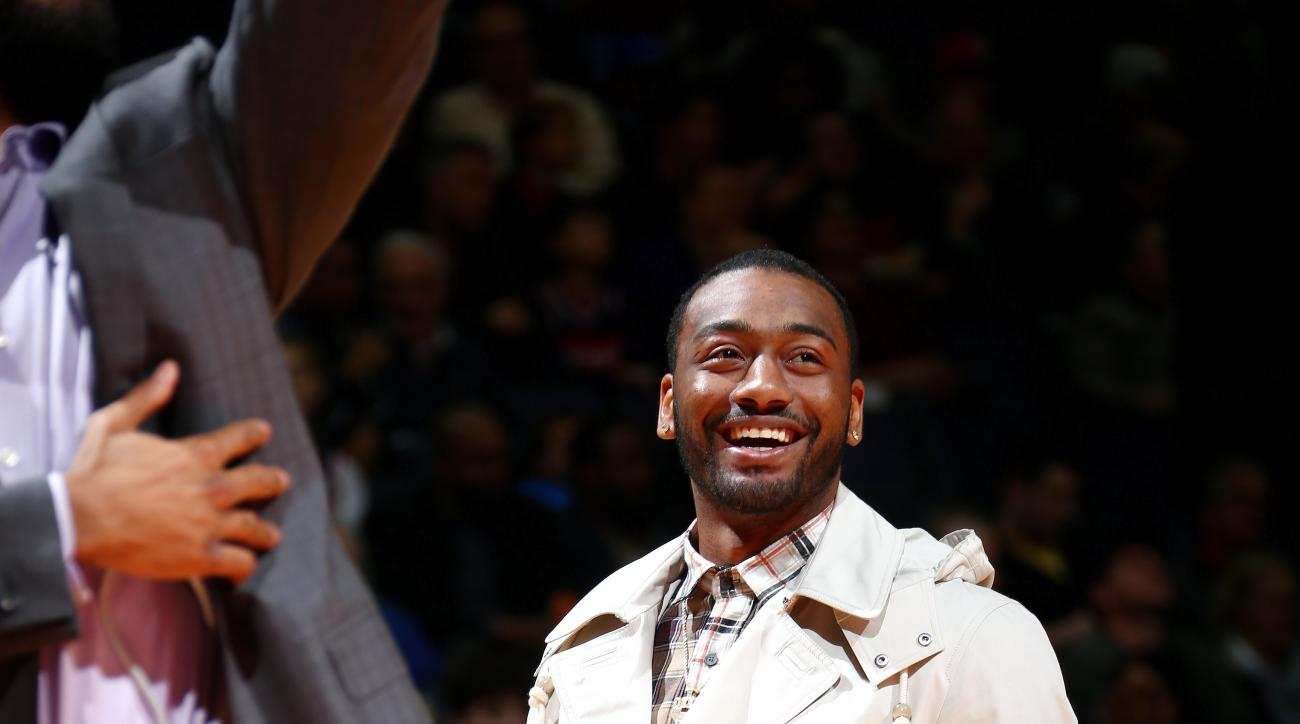WASHINGTON, DC - APRIL 6: John Wall #2 of the Washington Wizards looks on during the game against the Brooklyn Nets on April 6, 2016 at Verizon Center in Washington, DC. (Photo by Ned Dishman/NBAE via Getty Images)