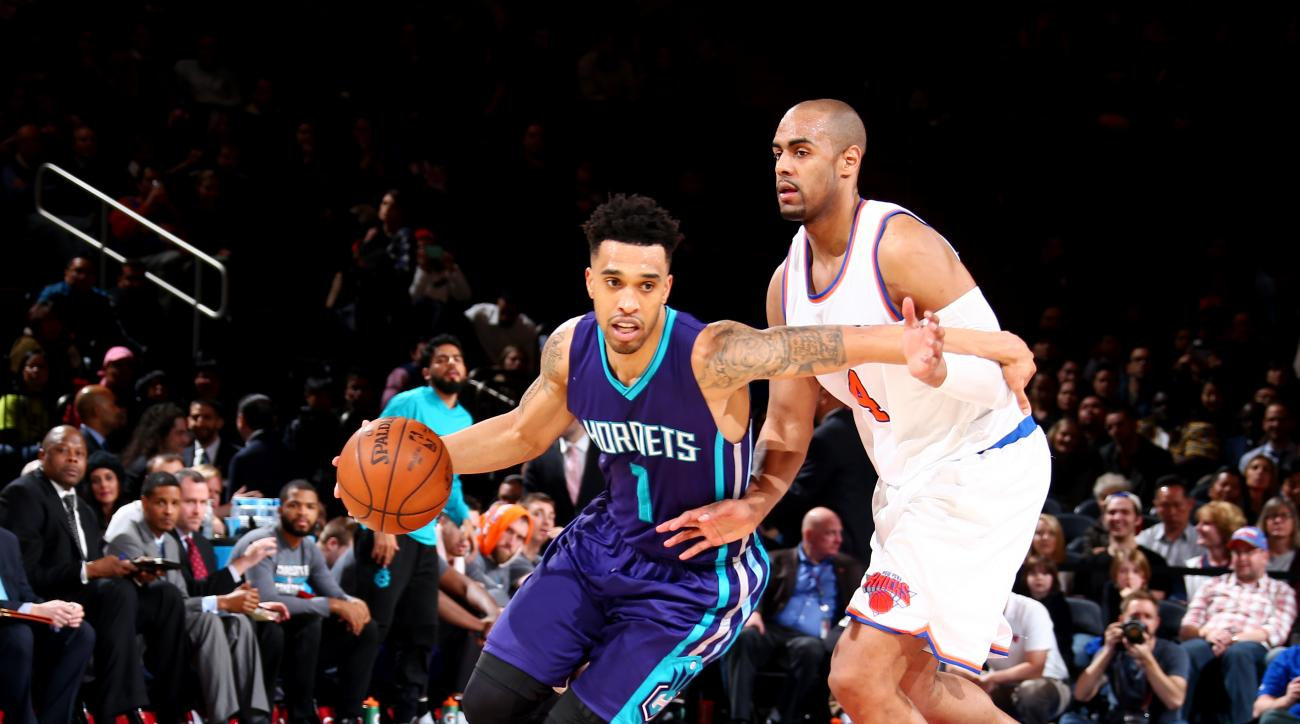 NEW YORK, NY - APRIL 6:  Courtney Lee #1 of the Charlotte Hornets drives to the basket against Arron Afflalo #4 of the New York Knicks on April 6, 2016 at Madison Square Garden in New York City.  (Photo by Nathaniel S. Butler/NBAE via Getty Images)